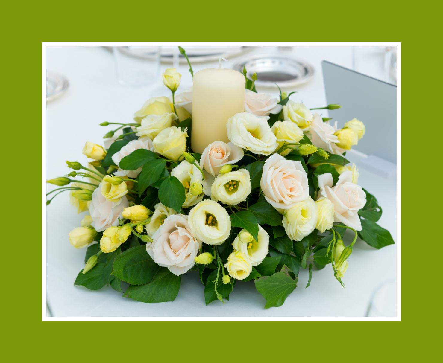 Blumengesteck aus Rosen & Ranunkeln