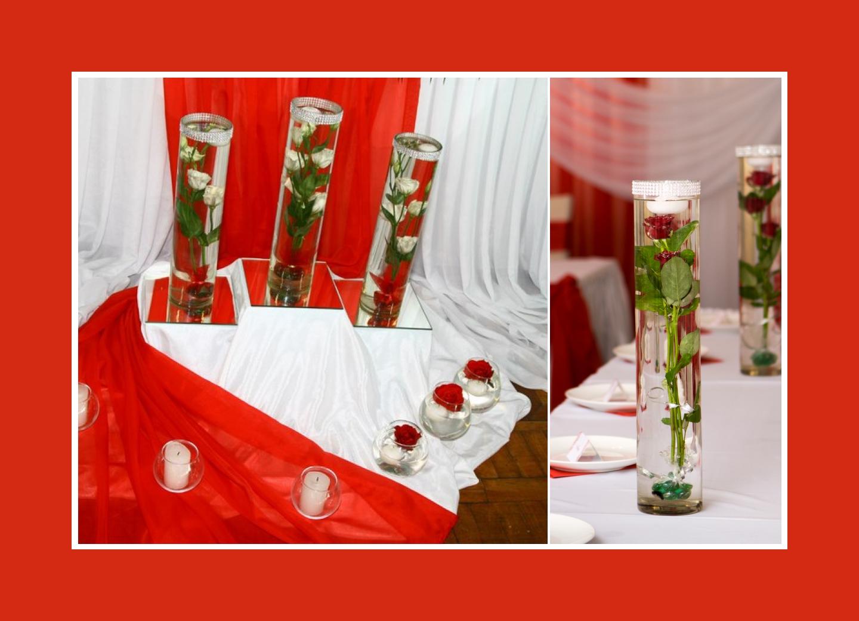 Deko vor dem Brautpaartisch mit Rosen und Kerzen