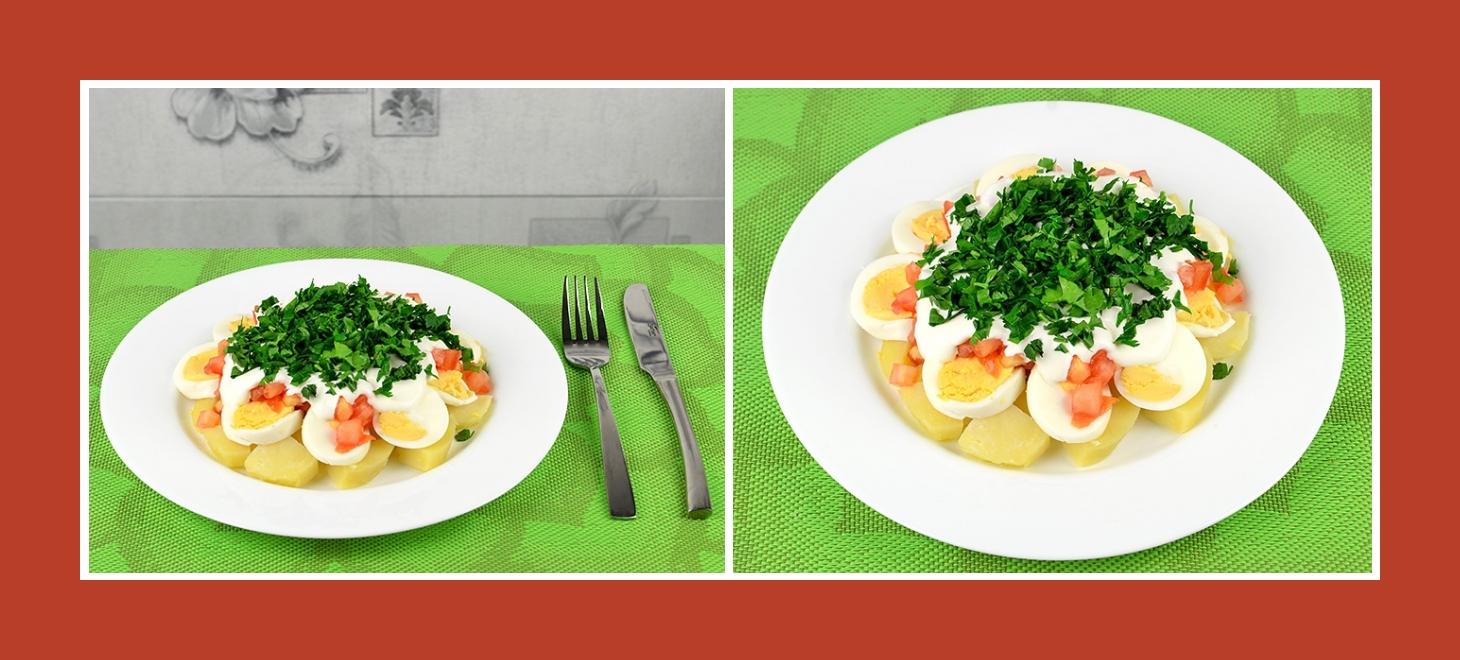 Zarter und nahrhafter Kartoffelsalat mit Schichten aus Eiern, Tomaten, Schmand und Petersilie