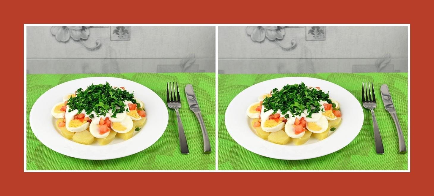 Gesunder Salat mit Kartoffeln, Eiern, Gemüse und Kräutern