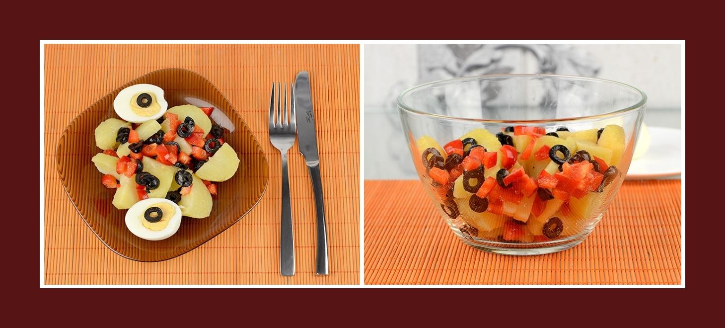 Kartoffelsalat mit schwarzen Oliven und roter Paprika