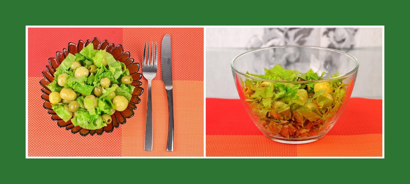 Erfrischender Salat aus Kartoffeln, Gartenssalat und grünen Oliven